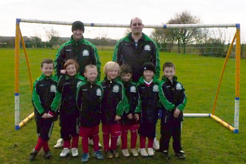 he under 7c Team wearing their rain jackets