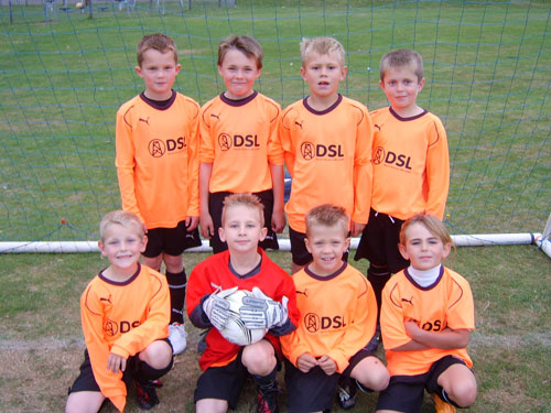 The under 8a team orange kit