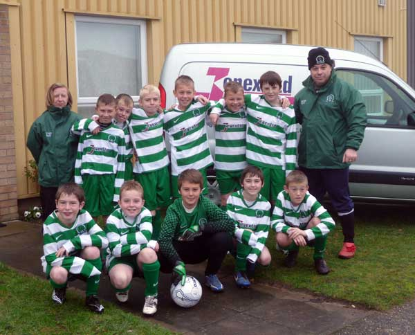 The Under 11 team in their home kit sponsored by Jenex