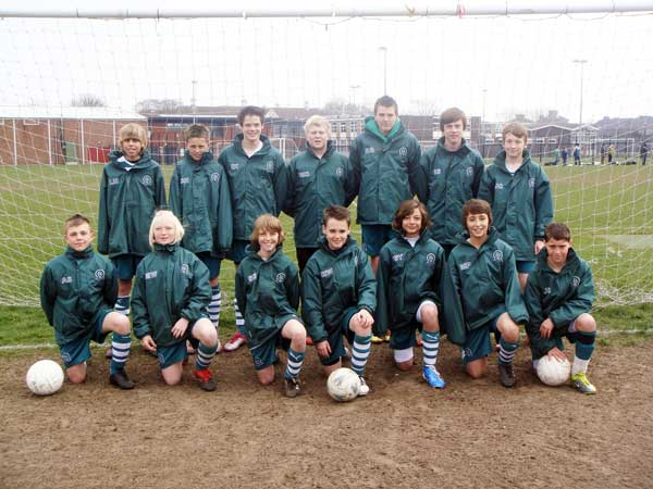 The u13a Team in Their Rainjackets