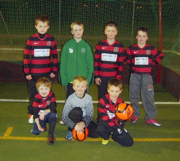 The under 9c team in their away kit