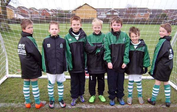The under 9c team rainjackets